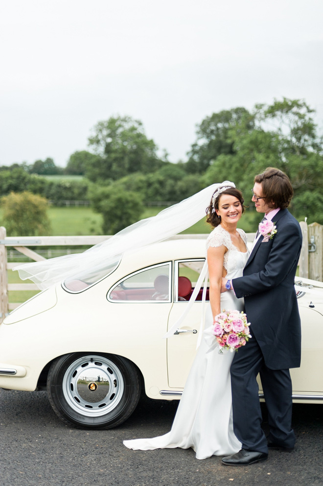 UK Bath Summer Wedding couple with vintage porsche & David Fielden dress