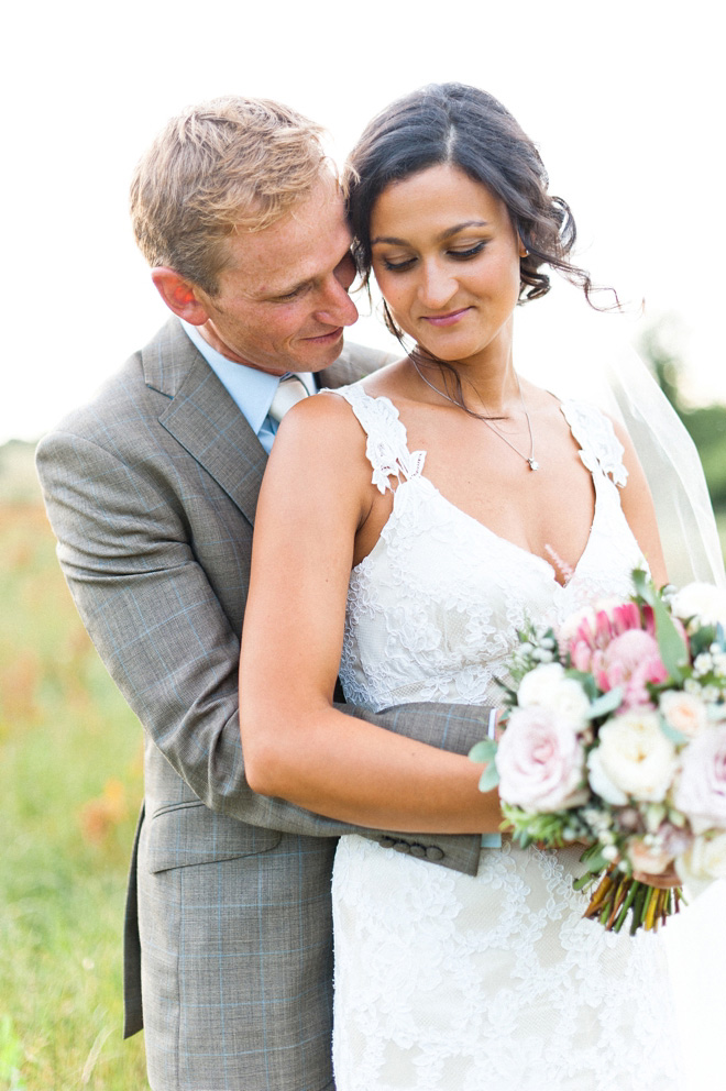 Surrey wedding with Claire Pettibone dress and protea bouquet