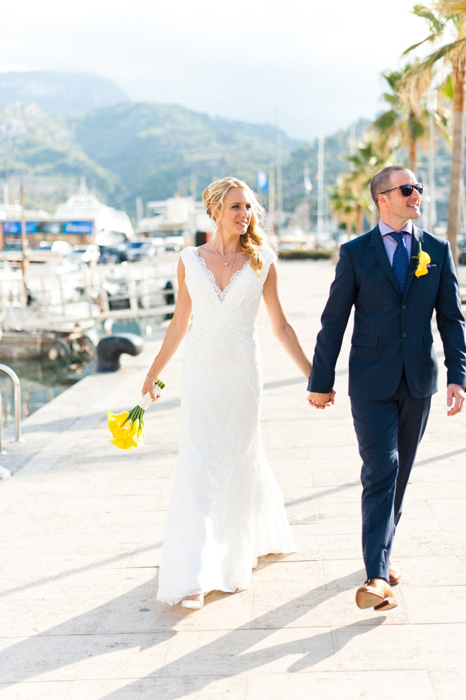 bride in Pronovias Wedding Dress with Groom by Soller Port in Mallorca Destination Wedding