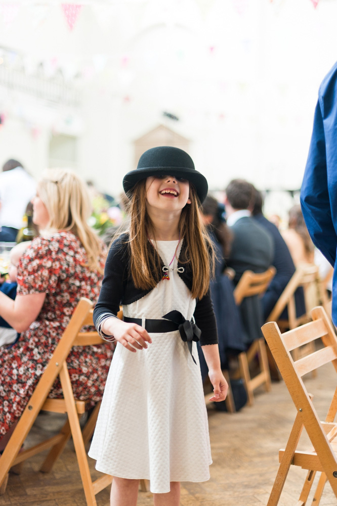 Child wedding guest in hat