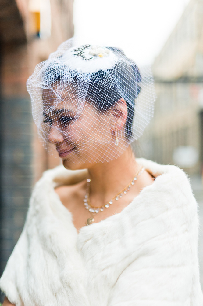 London bride in net vintage veil with feathers & fur stole