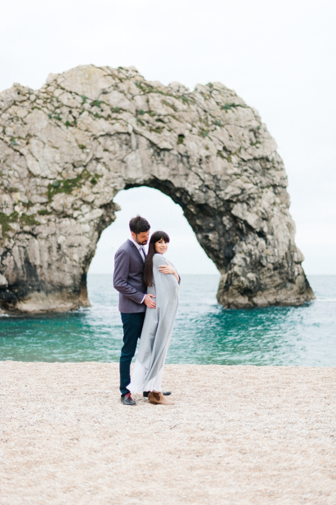 Engagement photo on beach dorset coast england