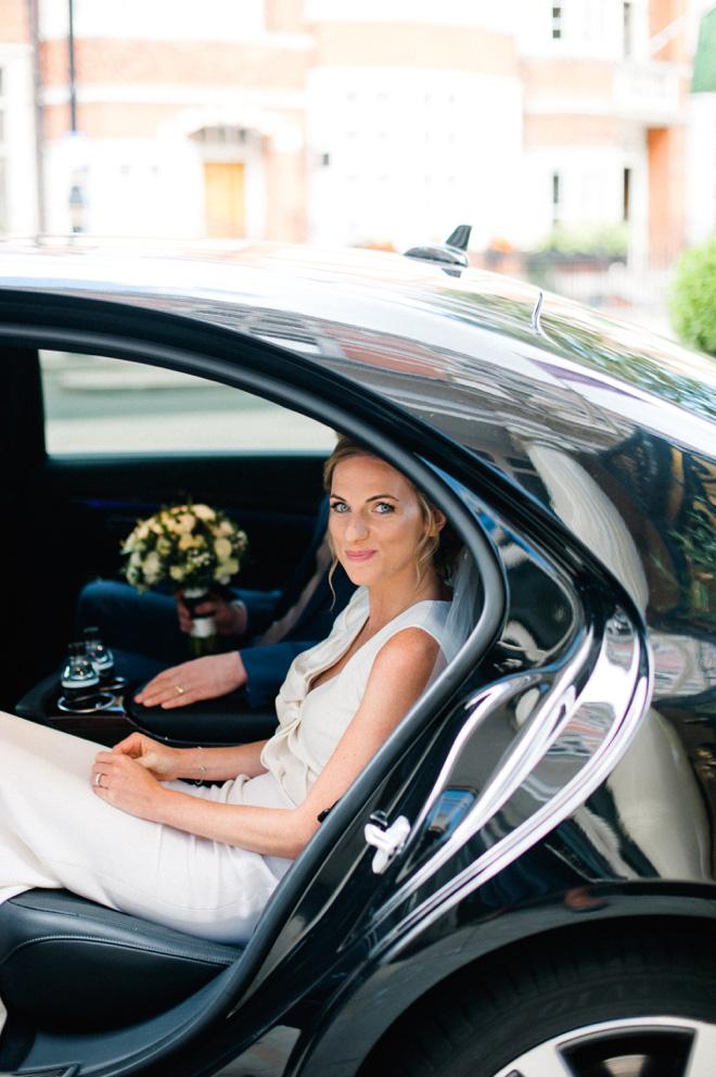 bride in black vintage rolls royce