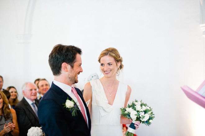 bride and groom smiling at one marylebone