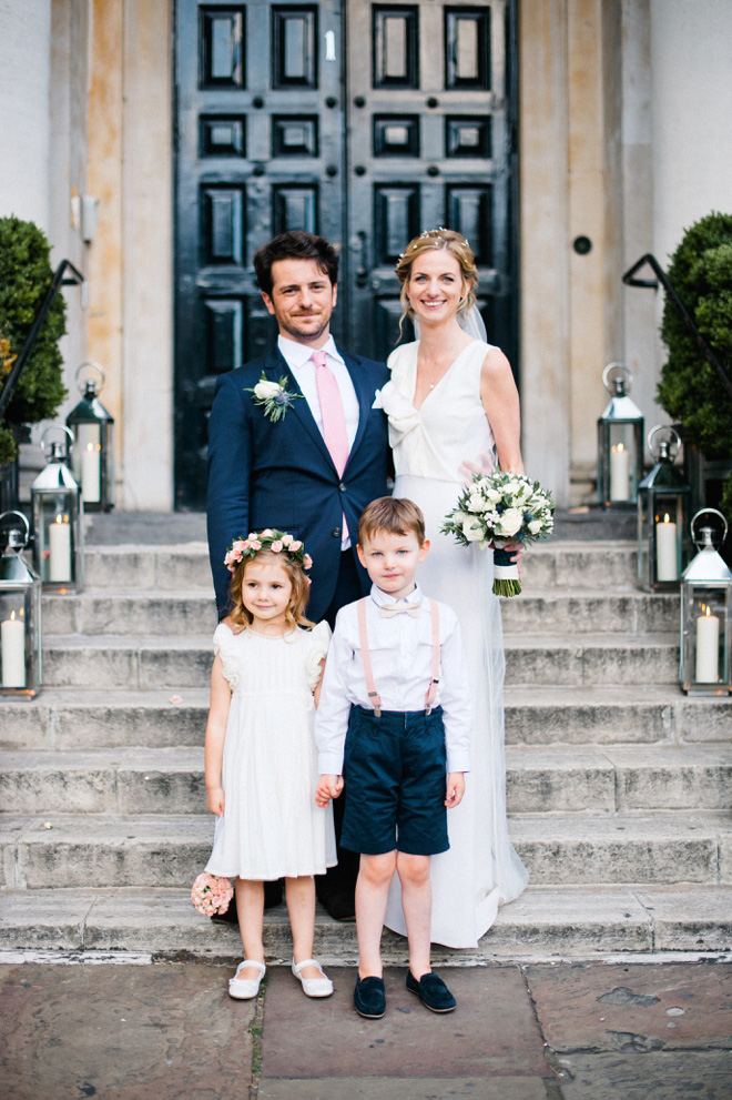 photo of flower girl and page boy with bride and groom at one marylebone