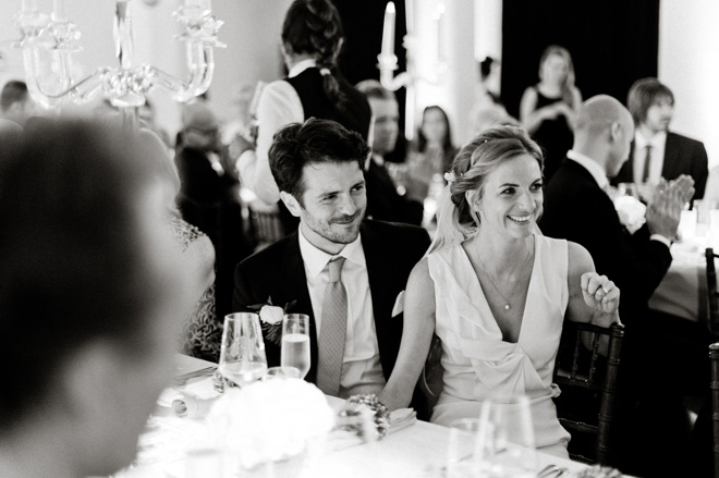 bride and groom laughing at best mans speech one marylebone
