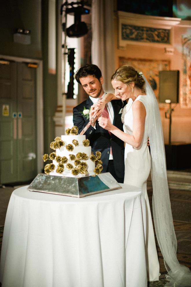 bride and groom cutting cake at one marylebone wedding
