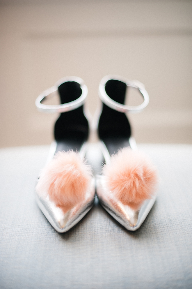 silver shoes with pink pom poms